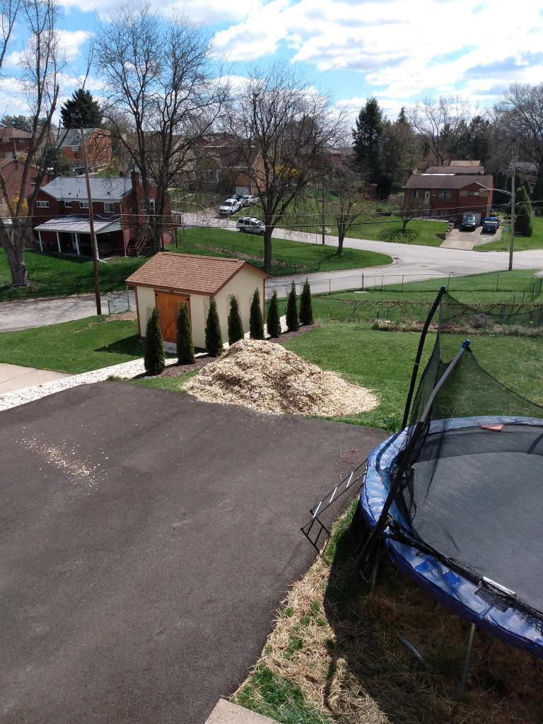Image of pile of woodchips at the end of driveway.