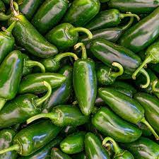 Jalapenos piled up on top of eath other.